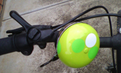 a granny smith apple transmogrified into a bike accessory